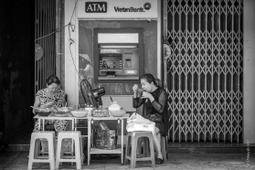 Eating while queuing for cash (and a hidden reflection) - Vietnam