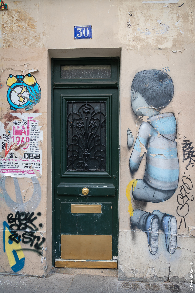 Mural of boy vanishing through a wall
