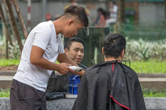 Street barber in Hanoi