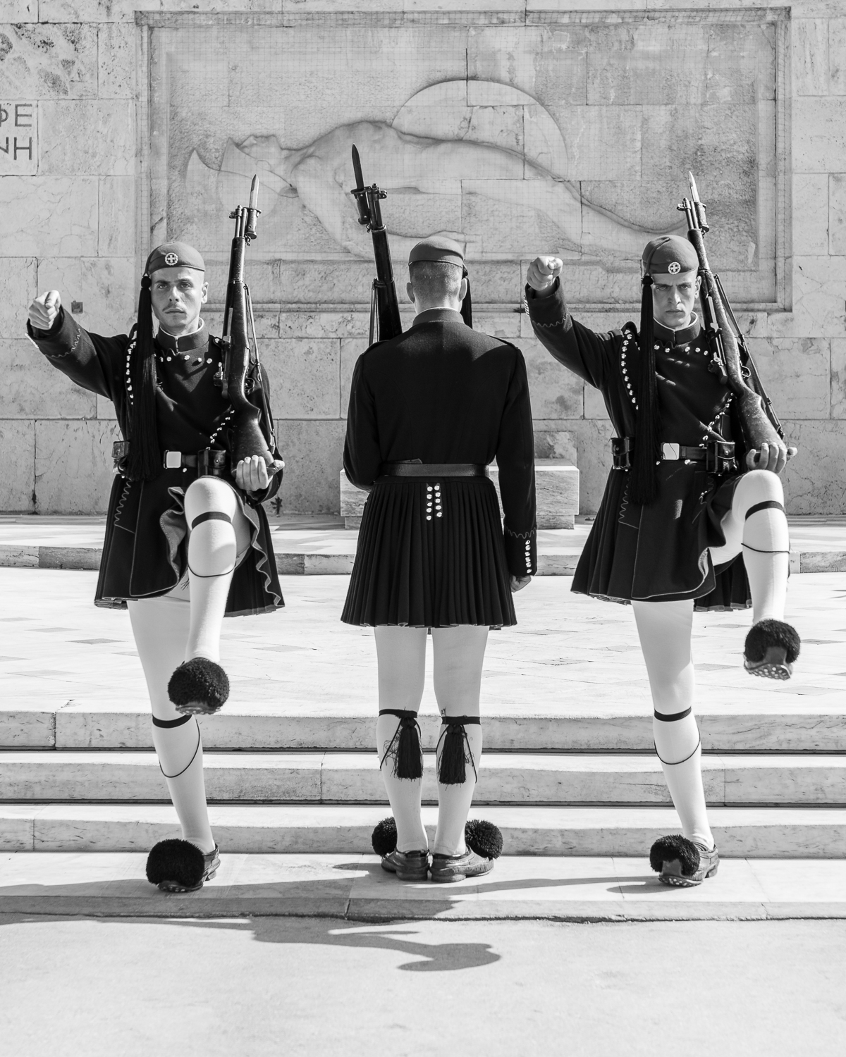 Greek Presidential Guard change guard in Athens, in black and white