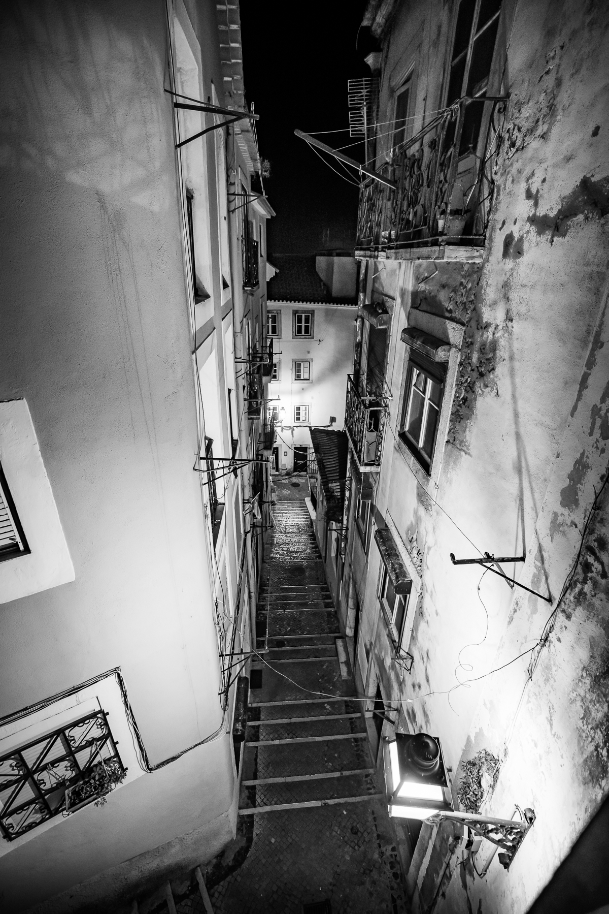 Lisbon Alfama at night. Black and white, local culture, steps