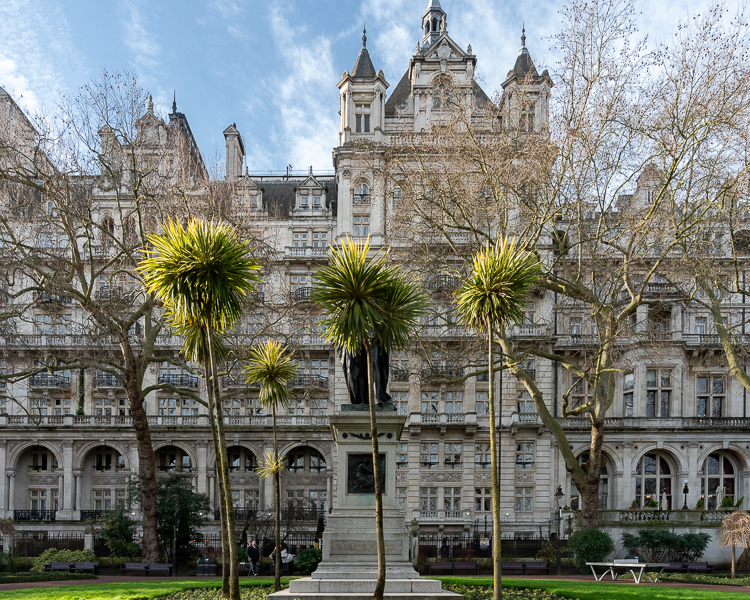 Palm trees hiding Statue of Henry Bartle Frere on embankment, London