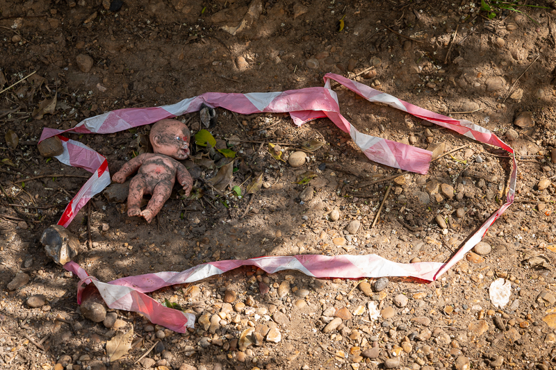 abandoned baby doll police tape crime scene