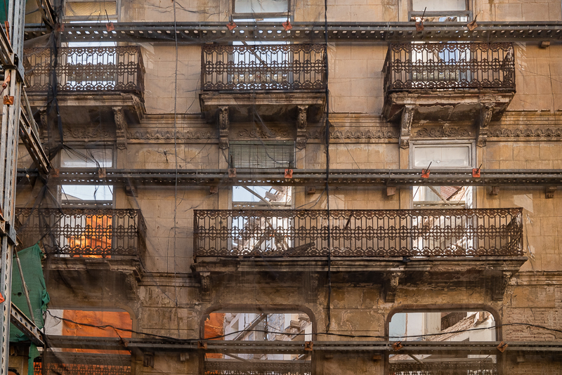 close up of building in Valencia under renovation, all but façade's destroyed