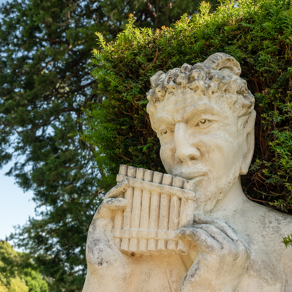 statue playing pan pipes