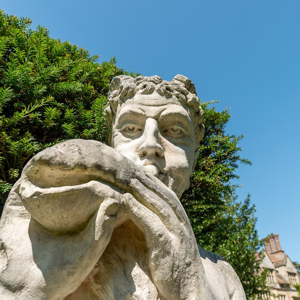 statue playing sea shell