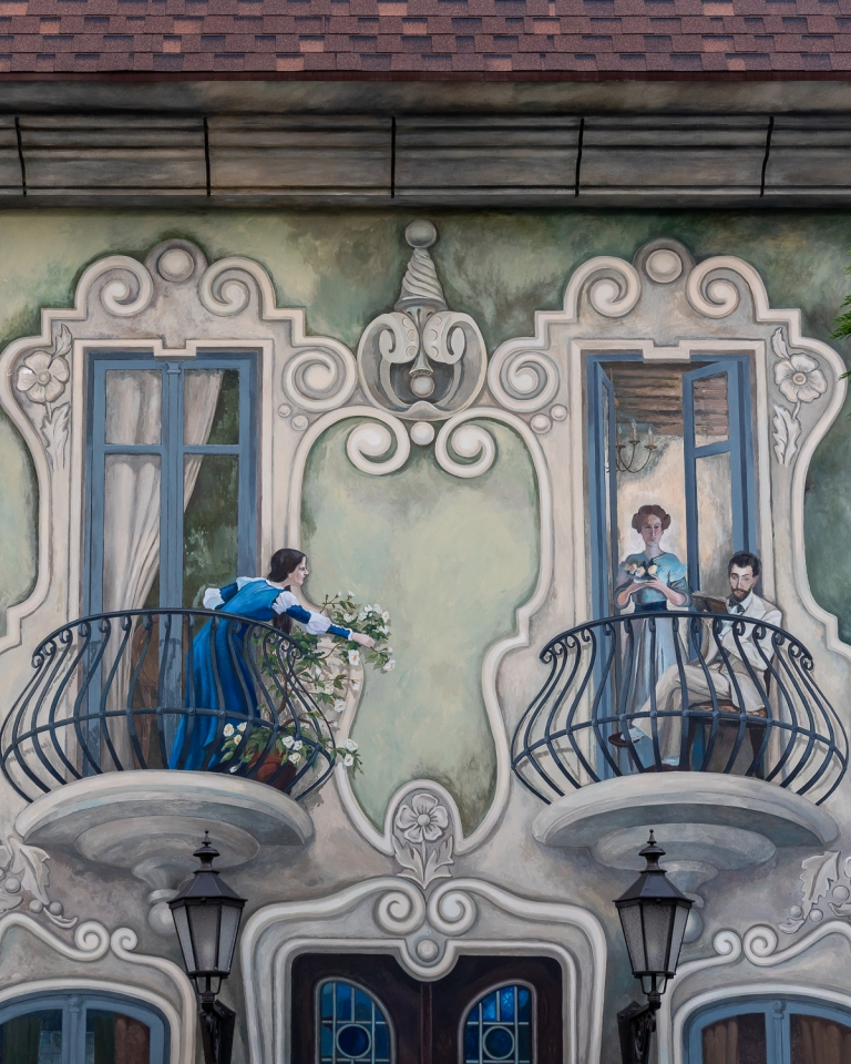 Close up of trompe l'oeil mural with people on balconies