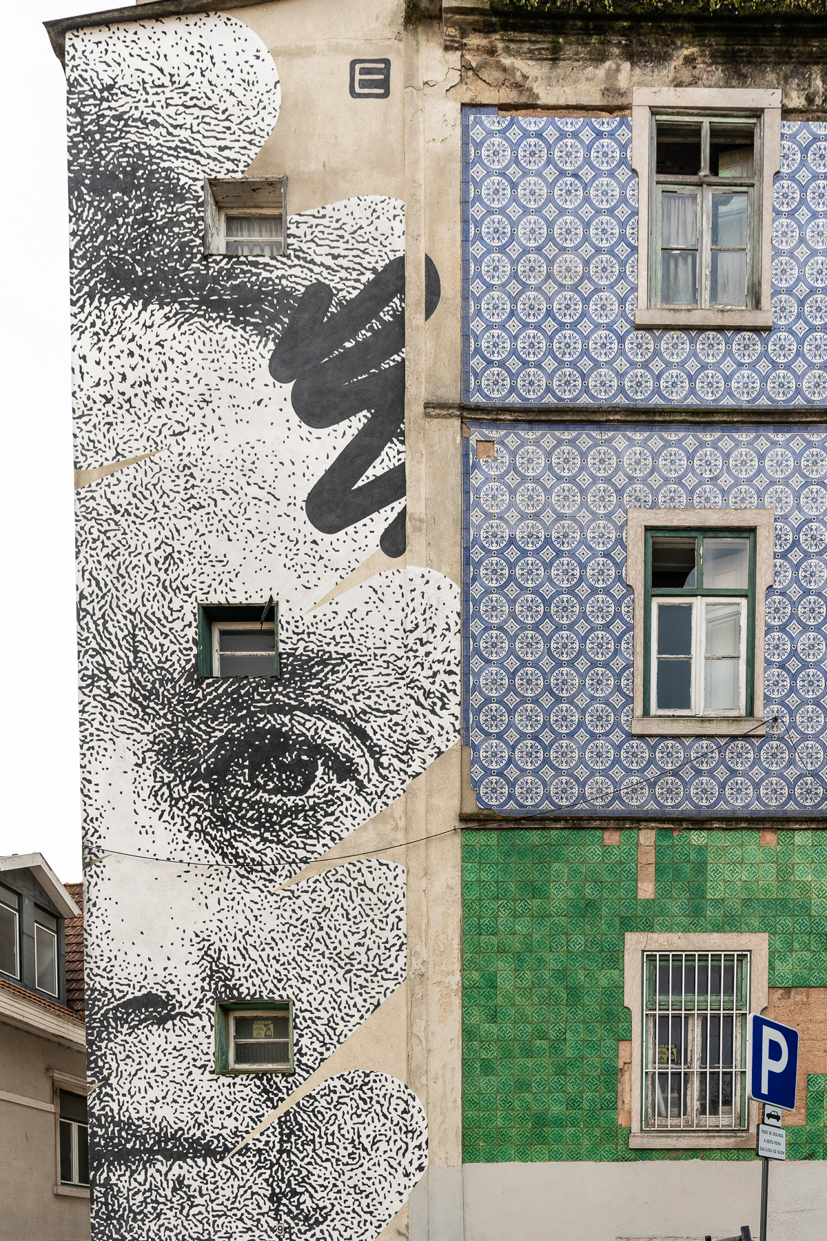 Stencilled black and white mural of the face of Sophia