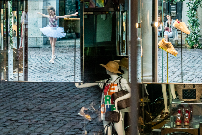 A your ballet dancer reflected in a shop window