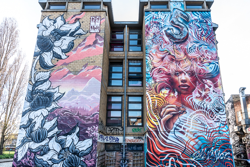 Two large bright murals on end of building