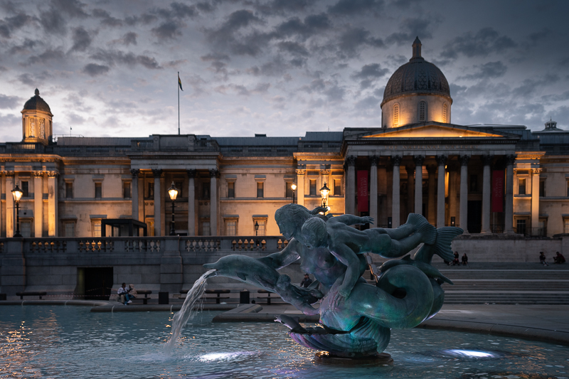 Fountain at Trafalgar Square at dusk