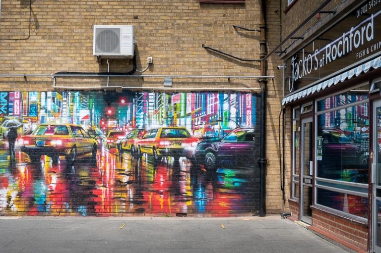 Night street scene mural on brick wall in Rochford