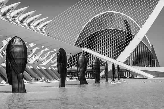 Jaume Plensa head sculptures and Calatrava bridge in the water at the City of Arts and Sciences in Valencia