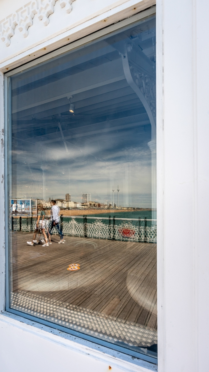 Reflection of Brighton and i360 in a window on Brighton Palace Pier