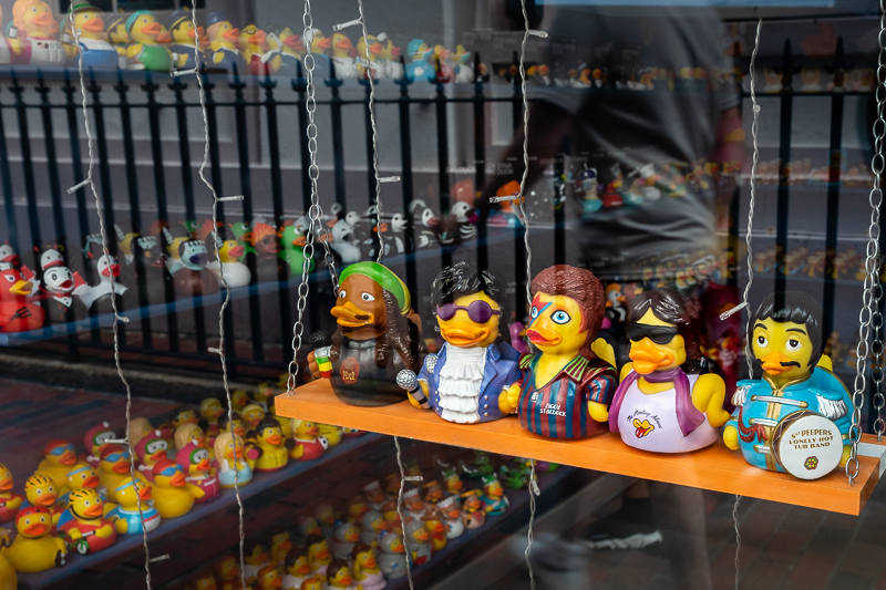 Toy ducks in shop window disguised as famous people