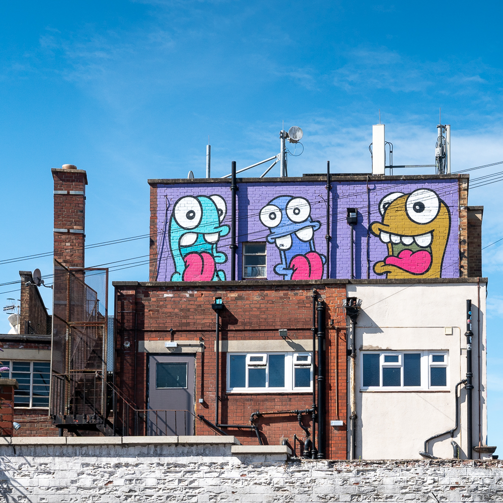 street art at the top of a building in Bristol
