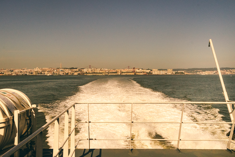 View back to Lisbon with Cristo Rei statue and 25 de Abril bridge visible