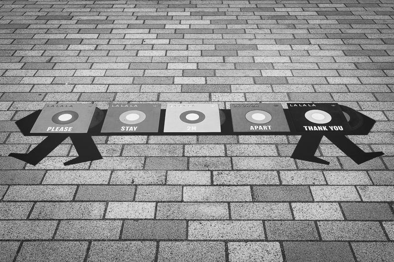 floor sign showing 2 metres