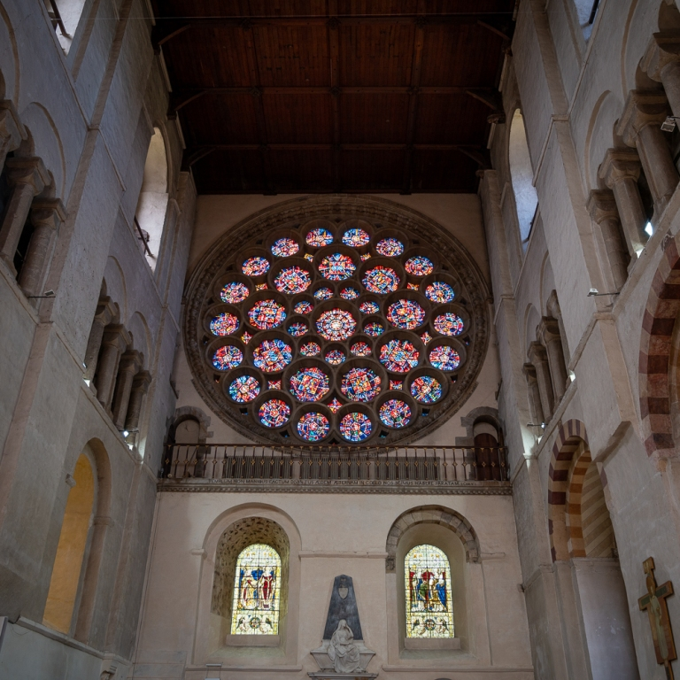 rose window and surrounding walls and arches of St Albans Cathedral