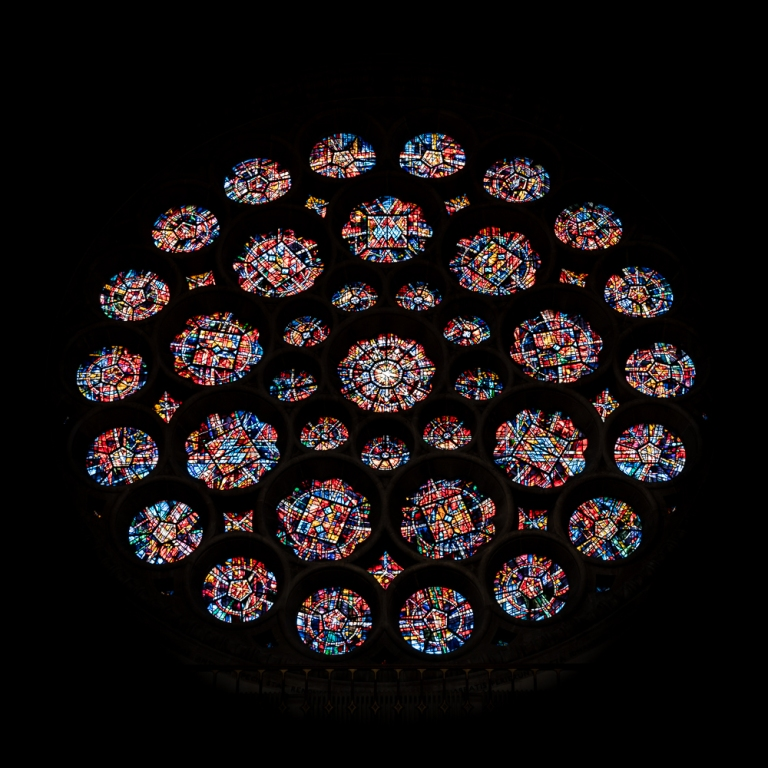 colourful rose window of St Albans Cathedral