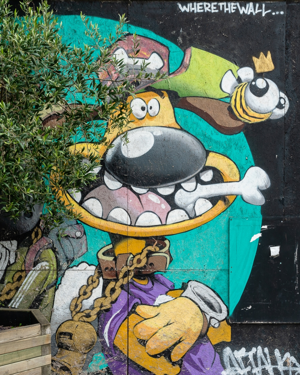 Wallace and Gromit mural, but Wallace is hidden behind a tree placed in front of it