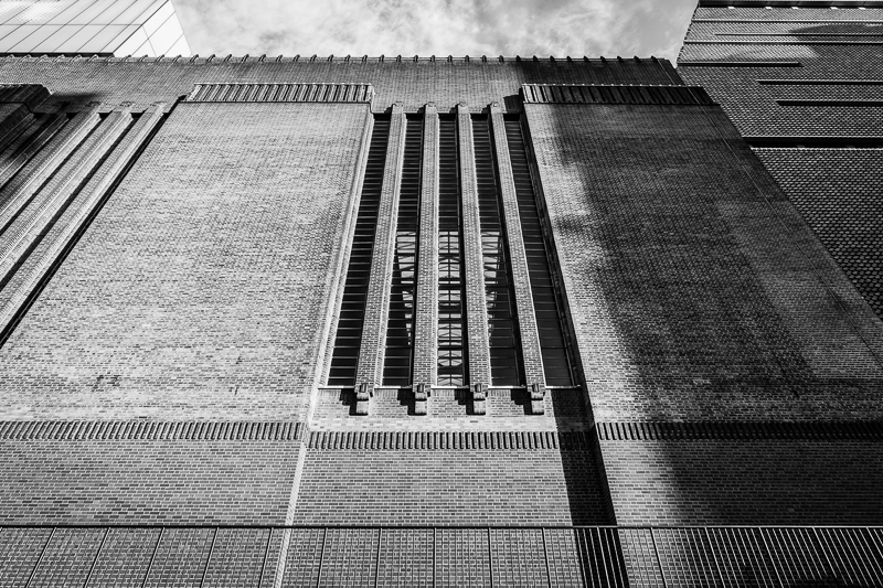 Looking up at Tate Modern, in black and white