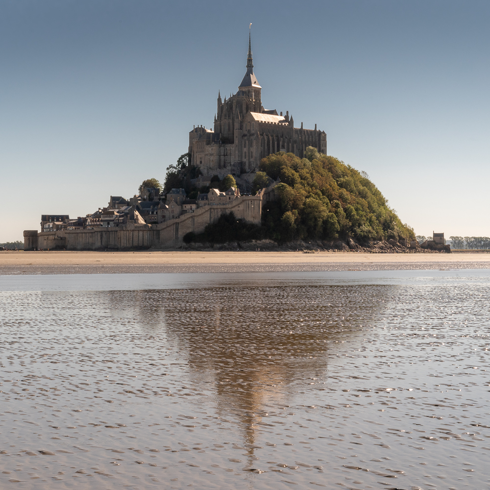 Mont St Michel with its reflection in the surrounding waters