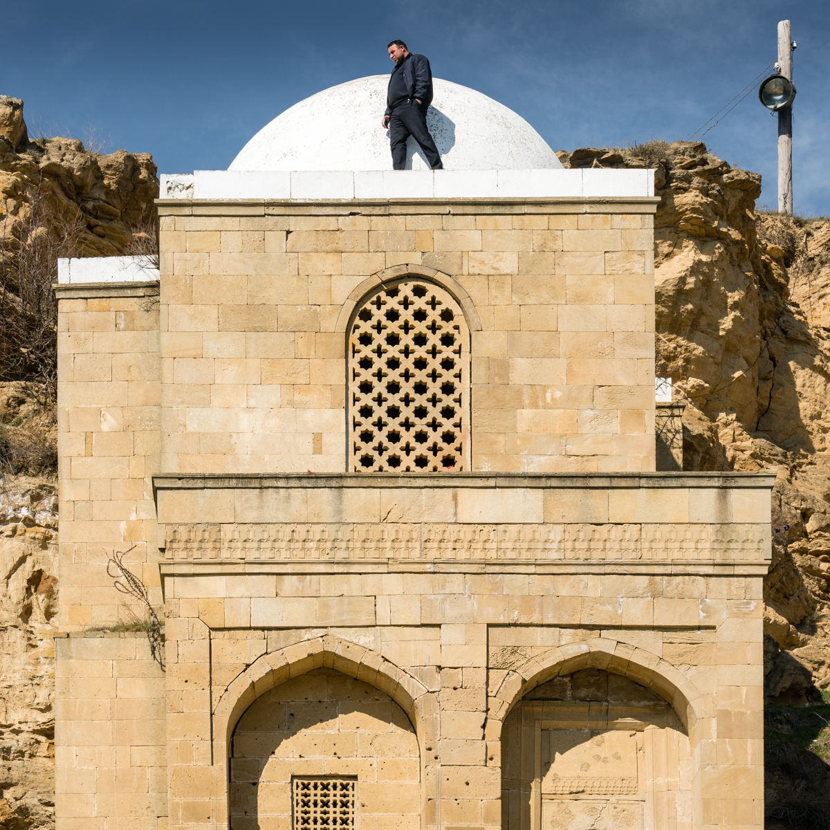 Close up, looking up at a mosque built into a cliff