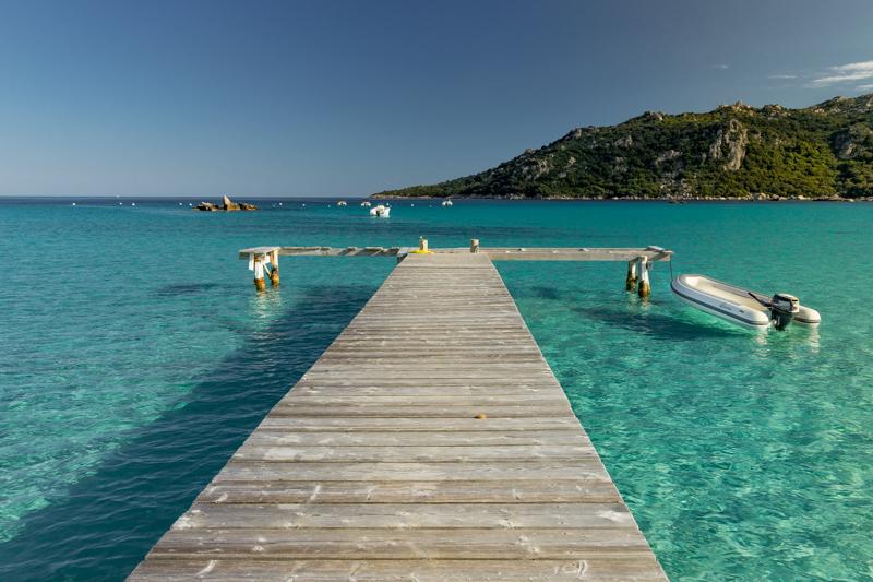 Wooden jetty into aquamarine sea