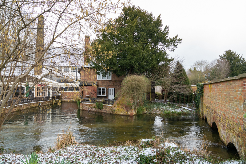 snow and rushing water at Kingsbury Watermill