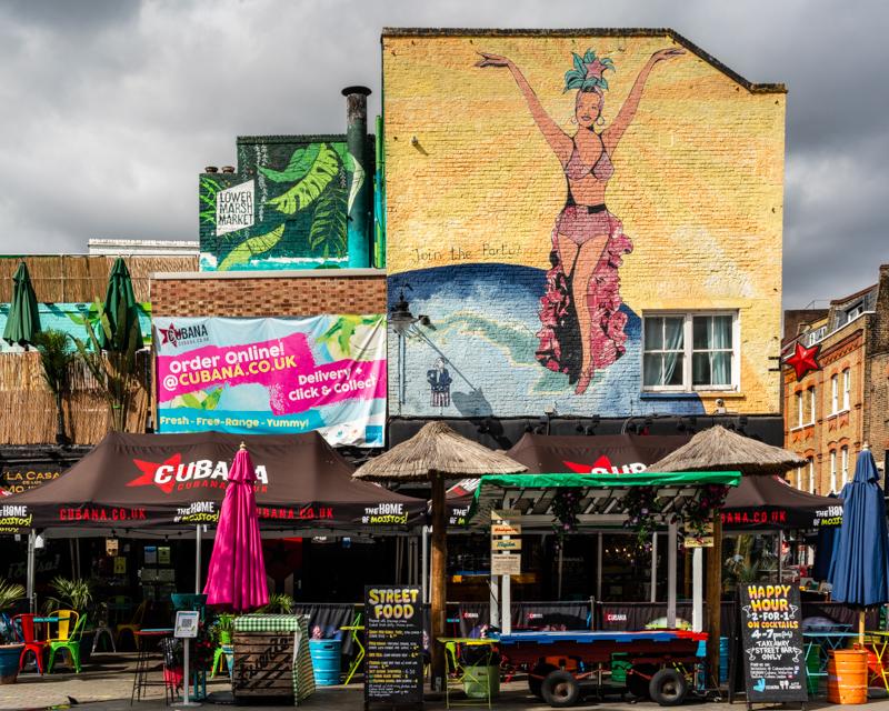 mural and food stalls outside Cubana