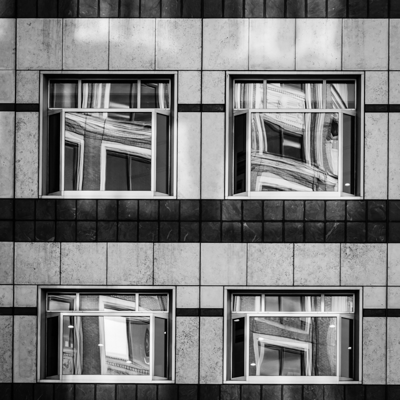 4 windows with reflections in black and white