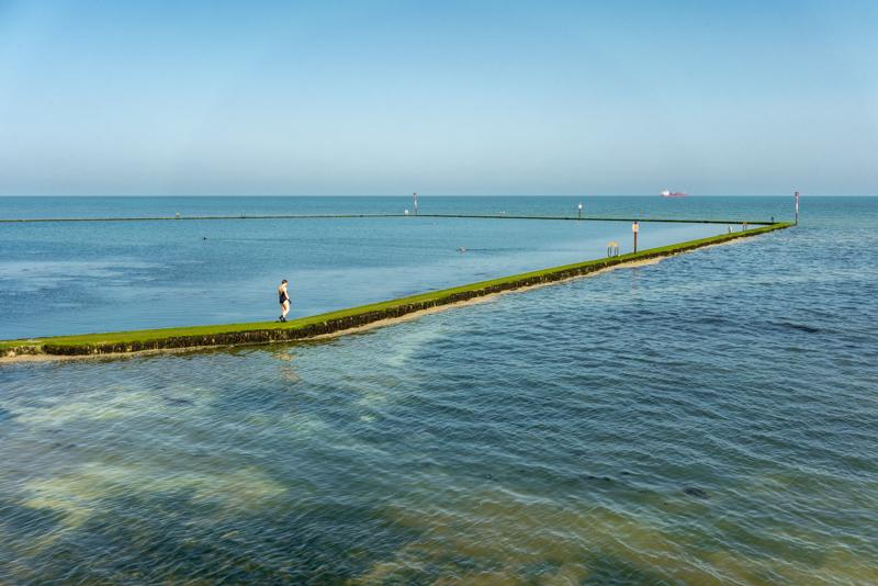 sea, tidal pool fading into sky